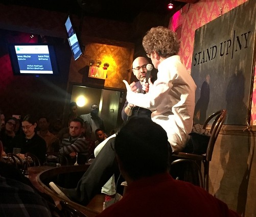 Photo: Aaron Price talks to James Altucher at Stand Up NY. Photo Credit: Rob Rinderman