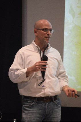 Photo: Ari Rabban speaking at Asbury Agile in 2013. Photo Credit: Khurt Williams