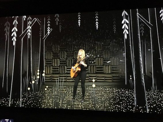 Photo: Beatie Wolfe singing with augmented reality illustrations around her. Photo Credit: Esther Surden