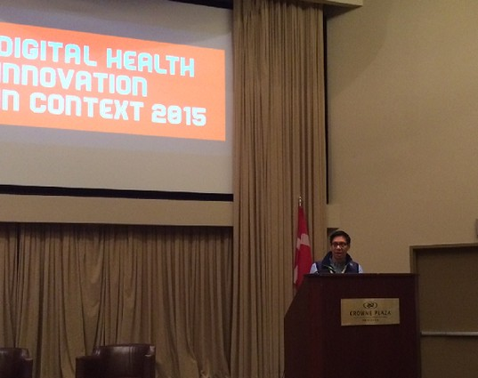 Photo: Bert Navarrete introduces the Digital Health Innovation in Context conference. Photo Credit: Esther Surden