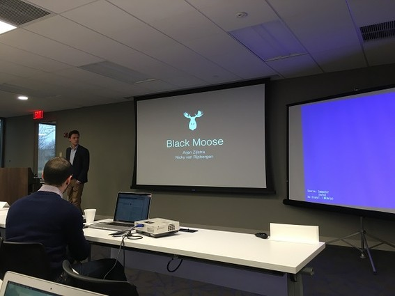 """Photo: The team called """"Black Moose"""" from the Technical University of Endhoven begins its presentation. Photo Credit: Esther Surden"""