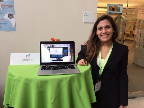 Photo: Carla Bahri at the ClickStick table Photo Credit: Esther Surden