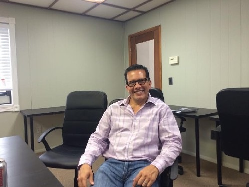 Photo: Carlos Abad at Summit Cowork, a coworking space he opened last year. Photo Credit: Esther Surden