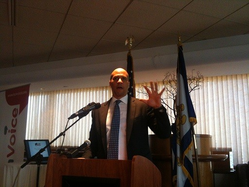 Photo: Cory Booker speaks to attendees at a TechVoice breakfast in Newark. Photo Credit: Esther Surden