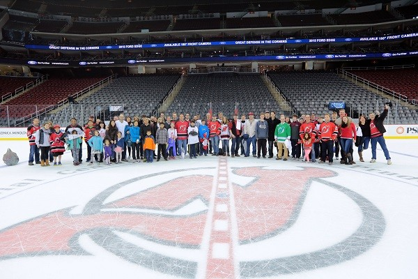 Photo: The group was able to take a photo on the ice after the game. Photo Credit: Courtesy NJ Devils