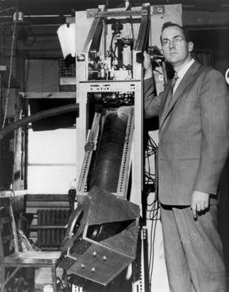Photo: Dr. Charles H. Townes, co-inventor of the laser, stands with a ruby maser amplifier, a device that paved the way for laser technology, in a 1957 photo. Photo Credit: Cortesy Alcatel-Lucent Bell Labs