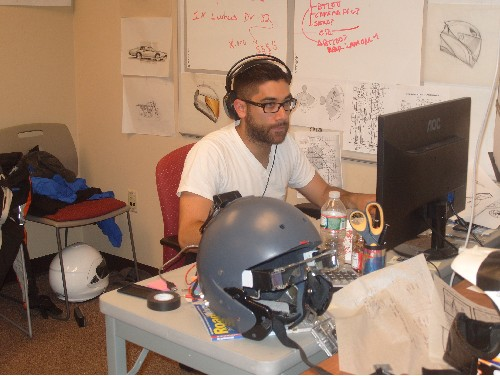 Photo: Fusar Designer Todd Rushing at work laying out the next prototype for their next gen augmented reality helmet. Photo Credit: Courtesy TechLaunch
