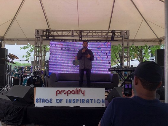 Photo: Gerard Adam addresses the crowd at the Stage of Inspiration at Propelify 2018. Photo Credit: Rob Rinderman