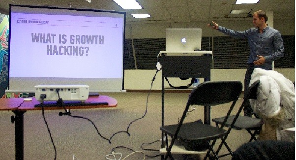 Photo: Conrad Wadowski spoke to a group at JuiceTank coworking space about growth hacking. Photo Credit: Steven Galante