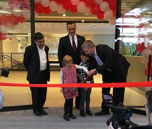 Photo: Ralph Zucker, Gregory Buontempo, Colin Day and the Day children cut the ribbon at iCIMS. Photo Credit: Esther Surden