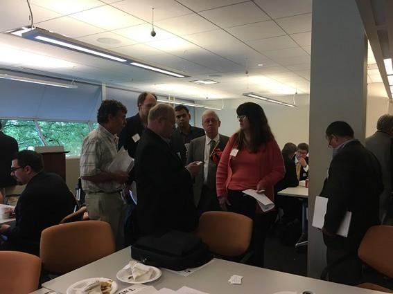 Photo: Jerry Creighton of Highlanders Angel Network talks to entrepreneurs. Photo Credit: Esther Surden