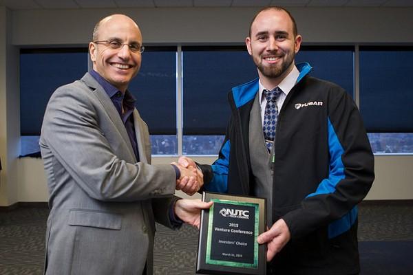 Photo: NJTC CEO Jim Barrood congratulates Ryan Shearman, CEO of FUSAR. Photo Credit: Courtesy NJTC