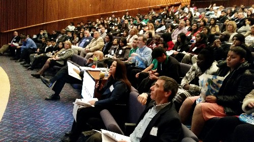 Photo: As a packed house looks on, the judges asked questions of the student presenters Photo Credit: Ellen Webner, AT&T