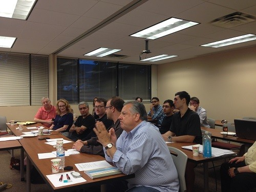 Photo: Mario Casabona and mentors listen to practice pitches at TechLaunch Photo Credit: Courtesy TechLaunch