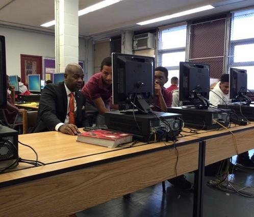 Photo: Newark Mayor Ras Baraka programming at an hour of code event. Photo Credit: Courtesy Designs by Zay