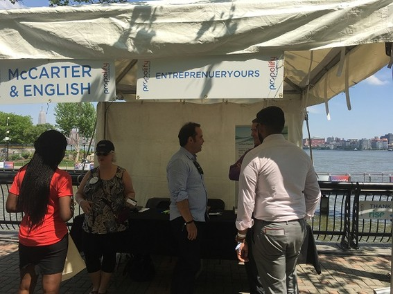 Photo: The McCarter and English / EntreprenYOURS booth at Propelify. Photo Credit: Esther Surden