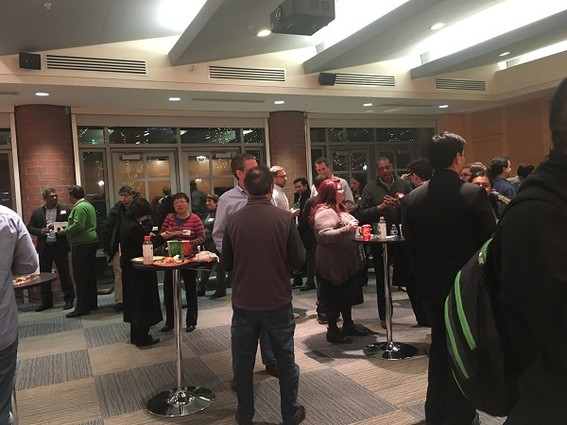 Photo: Networking at the 2016 Princeton Tech Meetup holiday event Photo Credit: Esther Surden