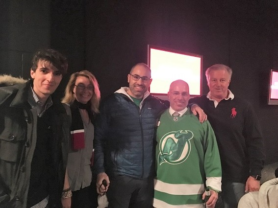 Photo: Networking at the Devils game. Photo Credit: Esther Surden