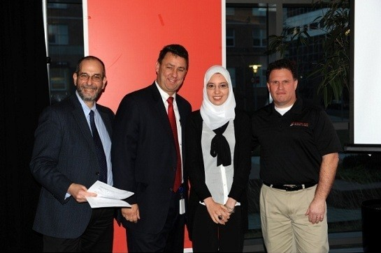 Photo: From L to R, NJIT Assistant Prof of Finance Michael Erhlich, Greg Smith, Senior VP of Group Sales, executive business banking at Capital One, Amira Essenghir and Dan Sterling, president and founder of Sterling Medical Devices. Photo Credit: Capital One