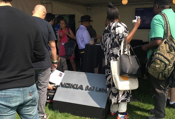 Photo: There were crowds at the Nokia Bell Labs tent. Photo Credit: Esther Surden