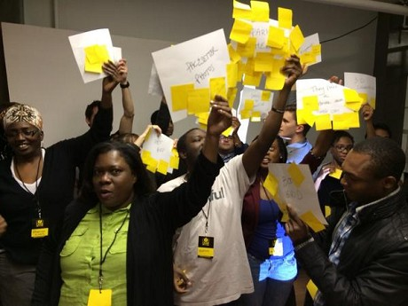 Photo: Participants in Lean Startup Machine Newark show off their votes Friday night. Photo Credit: April Peters