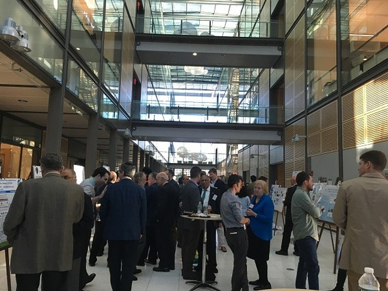 Photo: Judges and investors network and look at posters at the NJEN Posters and Pitches event. Photo Credit: Esther Surden