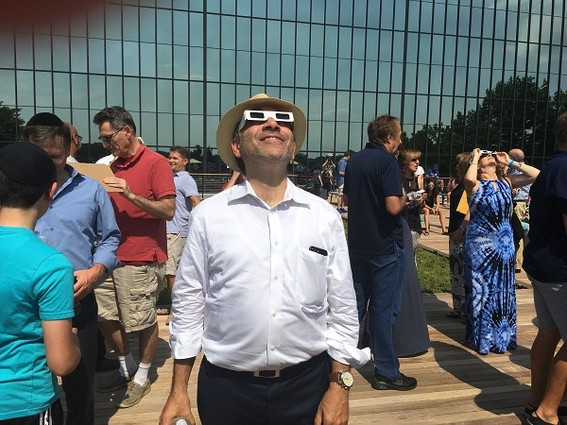 Photo: Bell Works, which has become a tech destination in Holmdel, hosted an eclipse party in August. We took many great photos that day, but the best one by far was of Ralph Zucker, president of Somerset Development, taking in the eclipse on the Bell Works terrace. To us, this photo symbolizes the return of life to the old Bell Labs space, a return of optimism for the tech industry in N.J., and the understanding that while we all work hard to build our businesses, there is always time to experience wonder. Photo Credit: Esther Surden