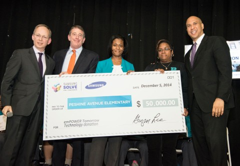 Photo: Samsung presents a $50,000 check to Peshing Avenue Elementary School in Newark. Photo Credit: Courtesey Samsung