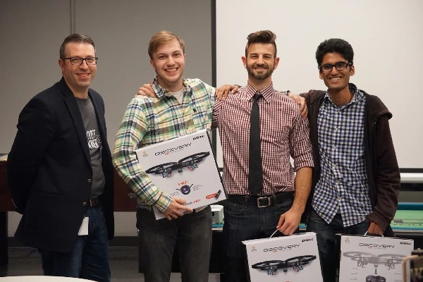 Photo: Second place winners Nicholas Feuer, Alben Kalambukadu, and Stanimir Stoychev holding their Drones. Zev Green, IDT Director of Emerging Technologies (far left). Photo Credit: Courtesy IDT Corp.