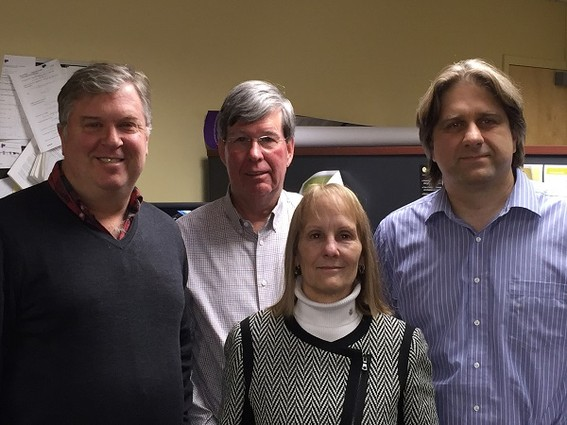 Photo: L-R in back:CFO-Steve Literati; VP of Engineering and cofounder Karl Beeson. In front, VP of Research and Development and cofounder, Gene Parilov, PhD and Mary Potasek, CEO. Photo Credit: Courtesy Simphotek