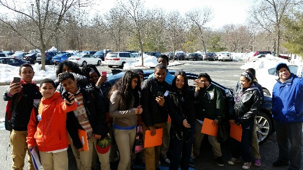 Photo: The students paused to take selfies with the GM connected car. Photo Credit: Ellen Webner, AT&T