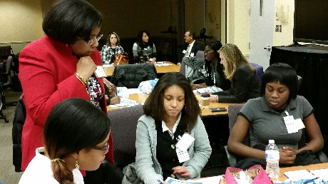 Photo: Students being mentored by employees with Joyce Henry (Network Engineering) in the front; Mercedes Morgan (Network Operations), Vere Hopper (Finance) in the background. Photo Credit: Ellen Webner, AT&T