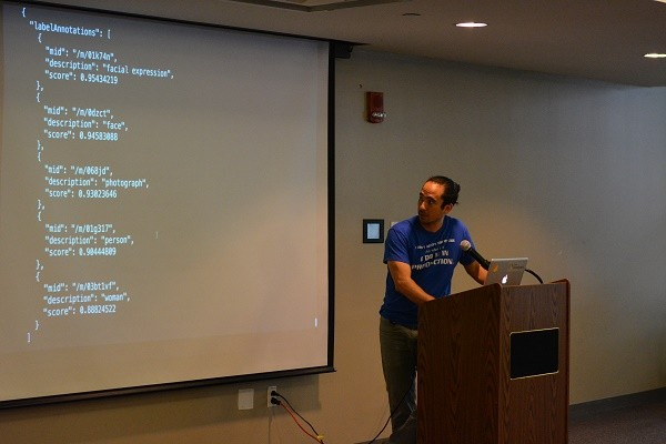 Photo: Todd Nakamura, founder of GDG North Jersey, giving a demo of the APIs Photo Credit: Hazel Lee, The Ideas Maker