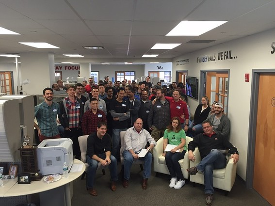 Photo: The entire V12 Group office joined the Rutgers Coding Bootcamp students for their group presentations. Photo Credit: Courtesy V12 Group