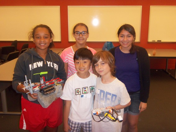 Photo: From left, Skyler Williams, Yasmine Petrocelli, Alyssa Ortiz and fellow students present their robot at the Stevens WaterBotics camp.