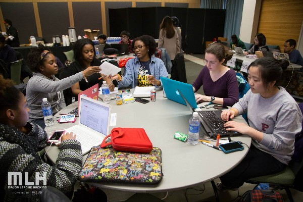 Photo: Participants hard at work at the HackHERS Hackathon at Rutgers Photo Credit: Nikolas Rassoules, courtesy of Major League Hacking