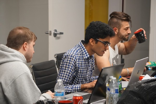Photo: Team hard at work coding Photo Credit: Courtesy IDT Corp.