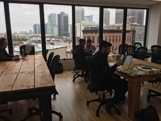 Photo: We visited Indiegrove coworking space in Jersey City in April with members of the NJ EDA. Look at the great view behind the folks working here! Indiegrove is home to a number of tech startup companies. Photo Credit: Esther Surden