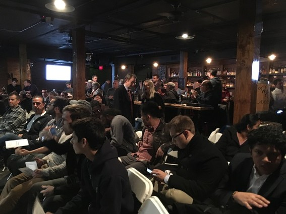 Photo: An enthusiastic, standing-room only crowd came to the Morris Tech Meetup event on virtual currencies and blockchain in December. The room was full of new faces and people we knew who wanted to learn more about these topics. To us this photo represents a groundswell of interest in these topics, spurred not only by the meteoric rise in the value of Bitcoin but also by tech interest in blockchain and how it will disrupt industry. We see this technology as the future and believe that many N.J. startup founders will be getting into blockchain now. Photo Credit: Esther Surden