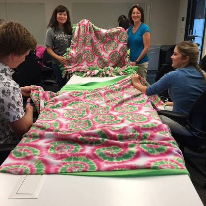 Photo: Employees made blankets for Project Linus. Photo Credit: Courtesy Commvault