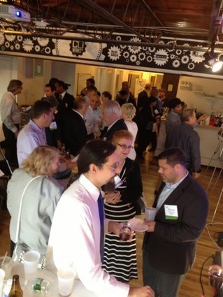 Photo: Attendees networking at the Tech Ideas and Demo Days event at Cowerks in Asuby Park. Photo Credit: NJTC