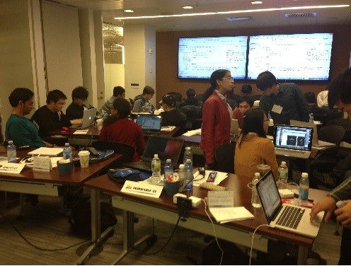 Photo: Teams working on their projects at the Juniper-Comcast Hackathon Photo Credit: Juniper