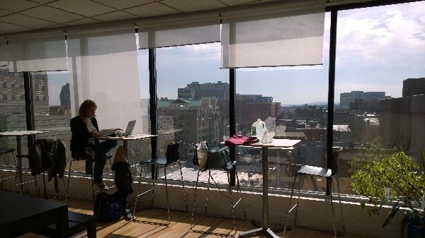Photo: Working at tables overlooking Jersey City Photo Credit: John Critelli