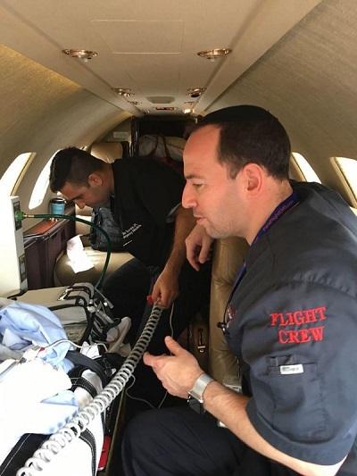 Photo of Sim Shain on an organ transplant flight